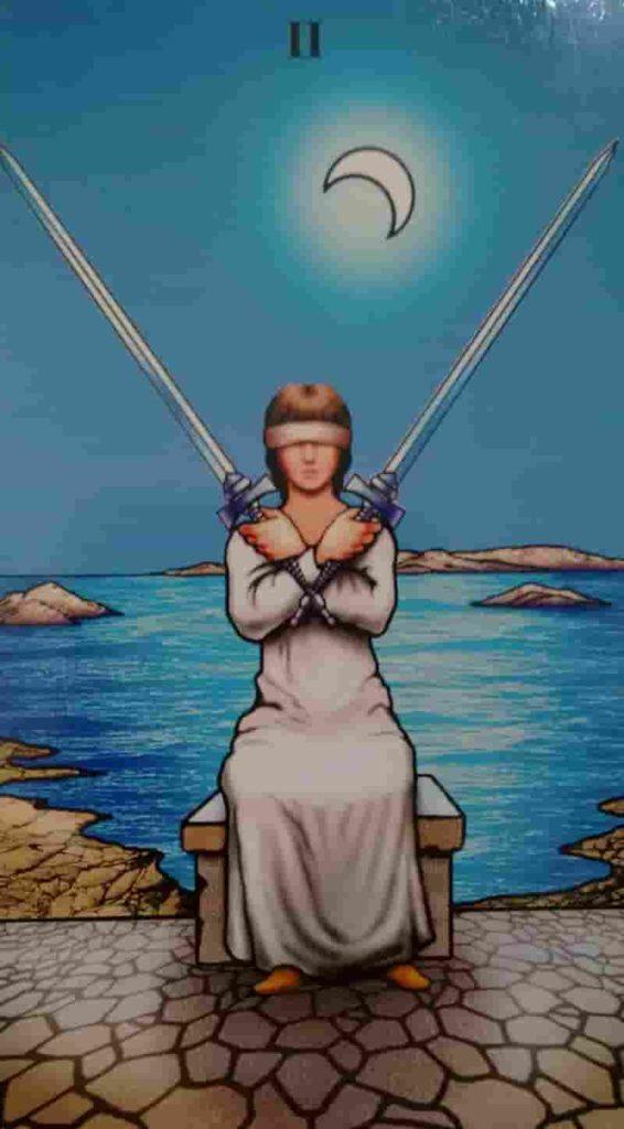 Conselho e Significado Carta de Tarot Dois de Espadas